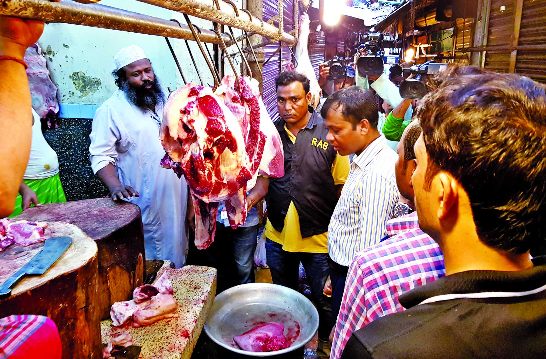 A mobile court led by a magistrate raided Kaptan Bazar meat shops in the city fined Taka four lakhs for selling rotten beef and also at a high price violating govt fixed rate. This photo was taken on Friday.