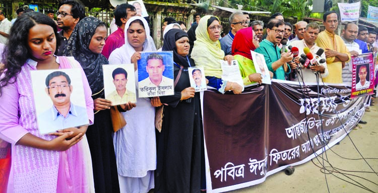 Members of enforced disappearance families formed a human chain in front of the Jatiya Press Club on Saturday marking International Day of Enforced Disappearance.
