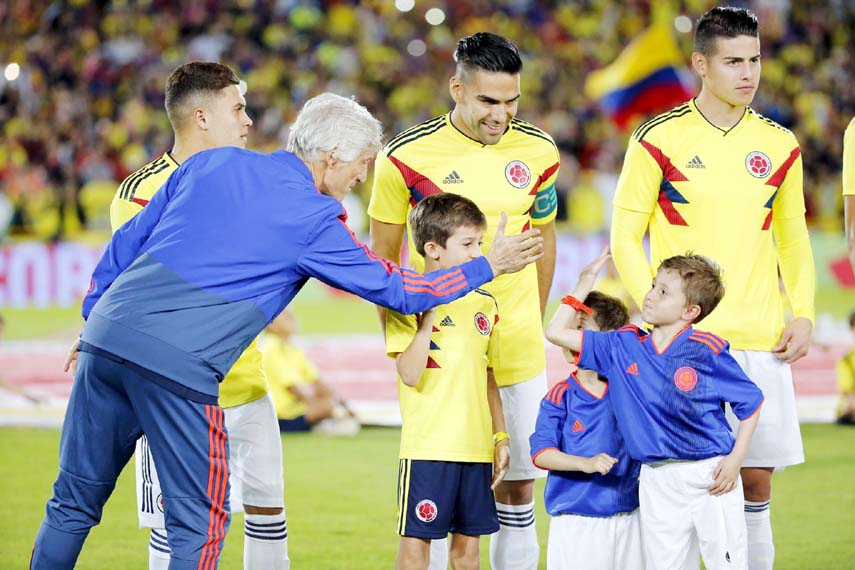 Colombia`s national soccer team coach Jose Pekerman greets a boy next to James Rodriguez (right) and Radamel Falco Garcia, second from right, prior to an exhibition match at the Nemesio Camacho stadium in Bogota, Colombia on Friday. Colombia will warm up and play a friendly match against Egypt in Italy before heading to Russia for the 2018 FIFA World Cup.