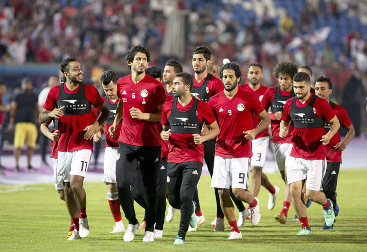 Egyptian national team soccer players warm up, during the final training of the national team at Cairo Stadium in Cairo, Egypt on Saturday. About 2,000 fans gathered at Cairo's main stadium on Saturday to watch Egypt's last home practice before the Pharaohs fly to their World Cup base in Grozny, Chechnya.