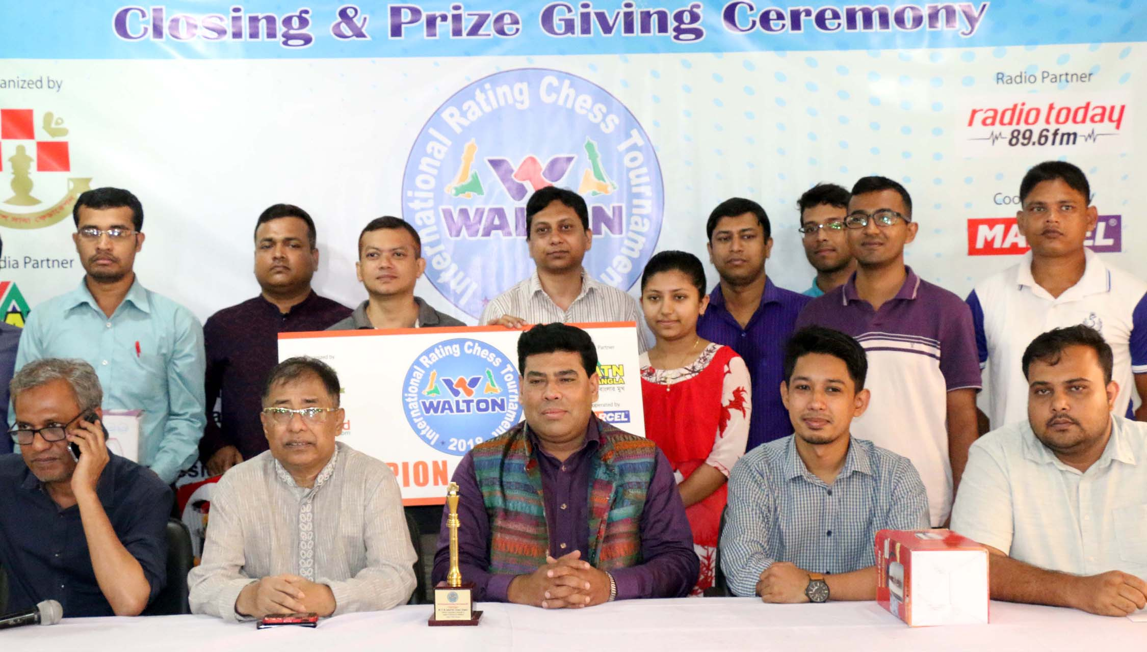 The winners of the Walton International Rating Chess Tournament with the guests and officials of Bangladesh Chess Federation pose for photograph at Bangladesh Chess Federation hall-room on Tuesday.