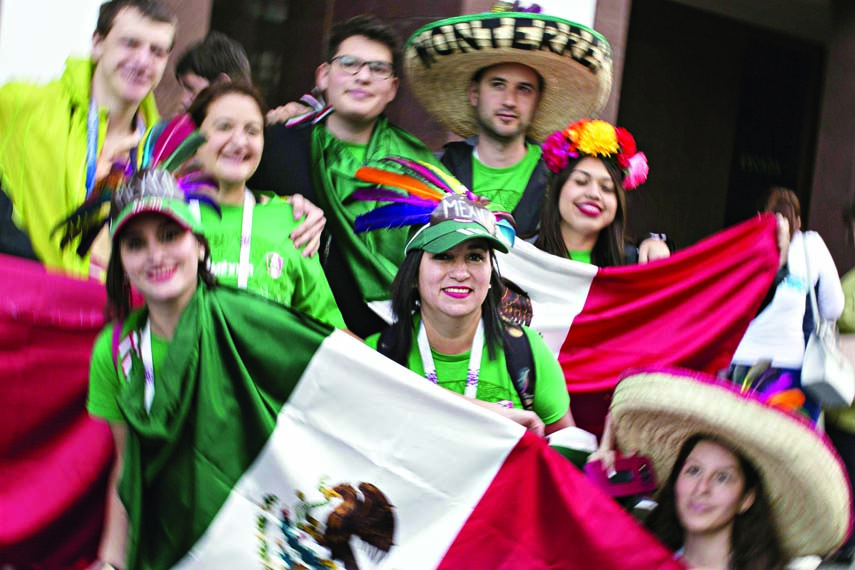 Mexican soccer fans pose for a photo on the eve of the opener of the 2018 soccer World Cup near Red Square in Moscow, Russia on Wednesday.