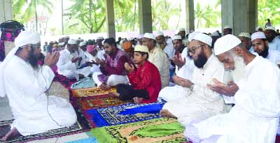 KHULNA; Participants offering Munajat of Eid congregation  at Central Jamat Mosque of Khulna University on Saturday.