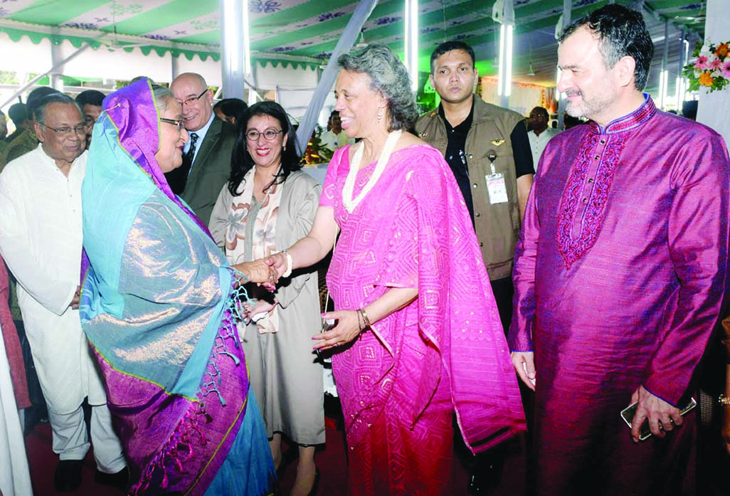 Prime Minister Sheikh Hasina exchanging pleasantries with diplomats at Ganabhaban in the city on Saturday on the occasion of holy Eid-ul-Fitr.