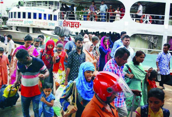 City-bound passengers have started returning after celebrating Eid-ul-Fitr with their near and dear ones at their ancestral homes. The snap was taken from Sadarghat Launch Terminal on Tuesday.