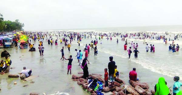 KUAKATA:  Tourists at Kuakata Sea Beach  enjoying Eid holidays. This snap was taken yesterday.