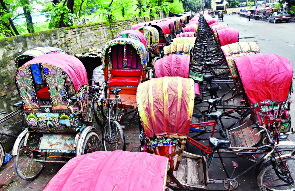 Rickshaws have been lined up in long queue in the streets as rickshawpullers left the city to celebrate Eid with near and dear ones in their village homes. This photo was taken from Tejgaon area on Tuesday.