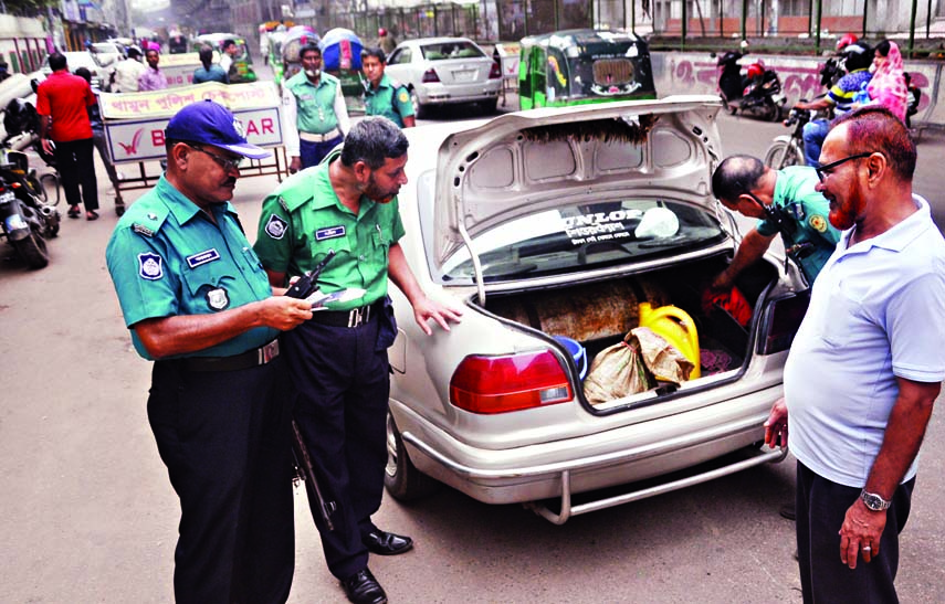 Law-enforcers checking commoners at the different points of the city on the occasion of Eid-ul-Fitr. The snap was taken from the city's Sayedabad area on Wednesday.