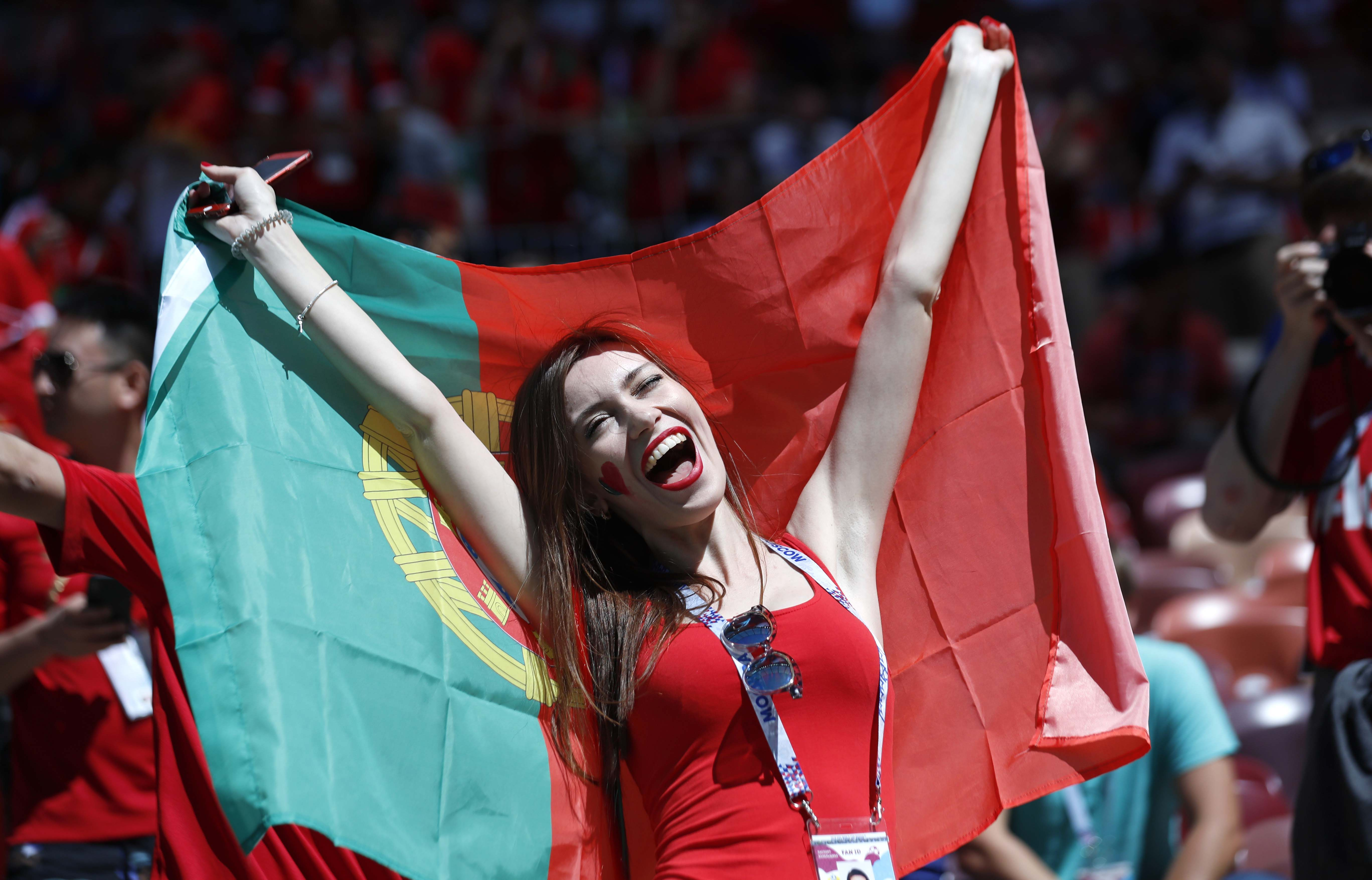 A woman holds a Portuguese flag prior to the group B match between Portugal and Morocco at the 2018 soccer World Cup at the Luzhniki Stadium in Moscow, Russia on Wednesday.