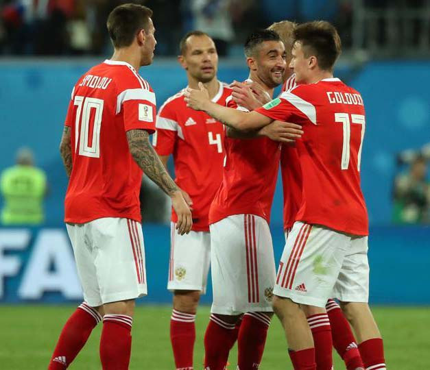 Russia players celebrate after the FIFA World Cup 2018 Group A match vs Egypt at the Saint Petersburg Stadium, Saint Petersburg, Russia on Tuesday.