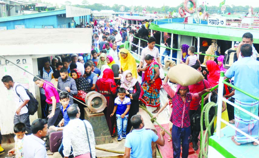 City-bound passengers returning after celebrating Eid-ul-Fitr with their near and dear ones at their ancestral homes. The snap was taken from Mawaghat on Thursday.