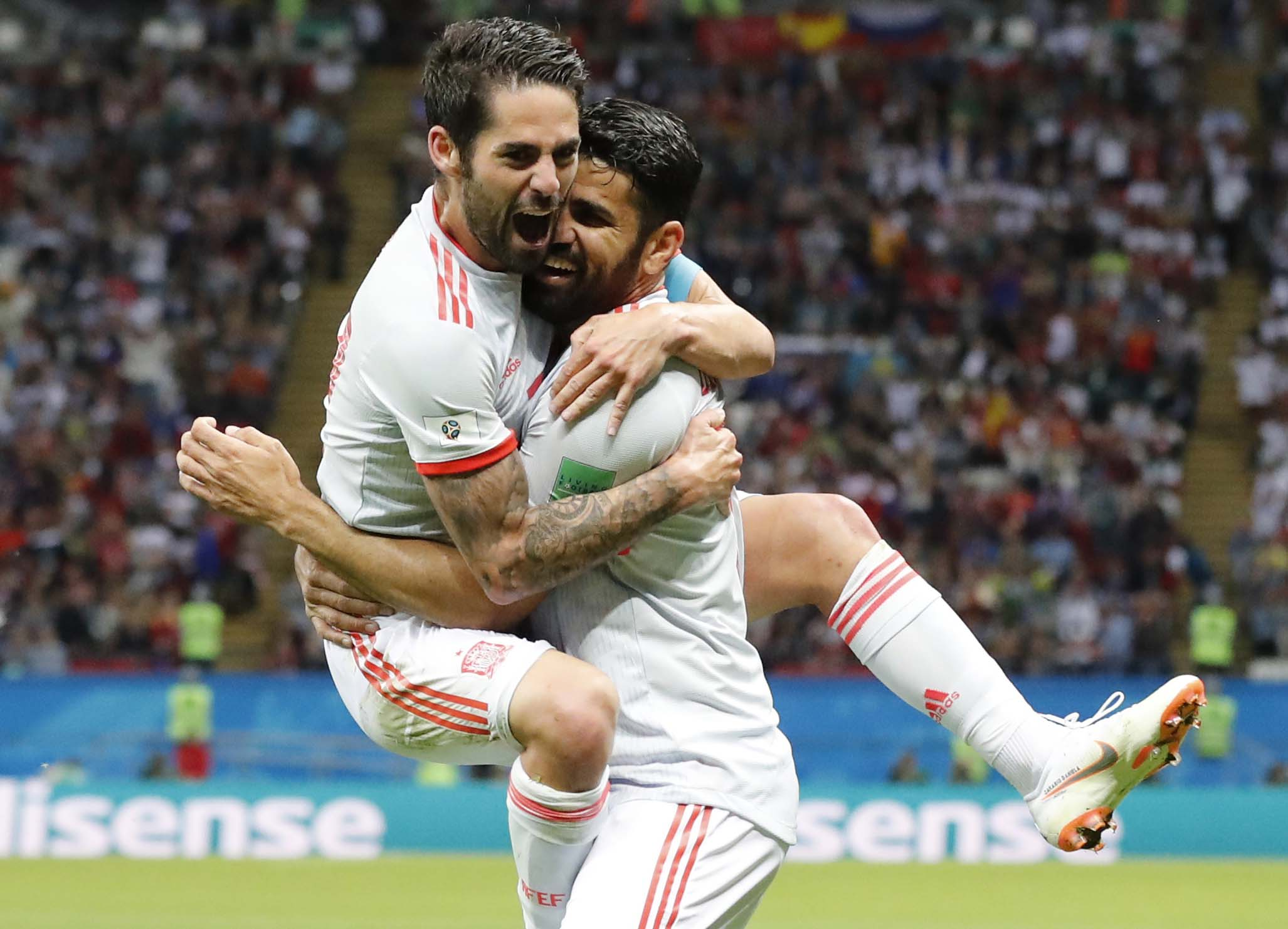 Spain's Diego Costa (right) celebrates with his teammate Isco after scoring his side's opening goal during the group B match between Iran and Spain at the 2018 soccer World Cup at the Kazan Arena in Kazan, Russia, on Wednesday.