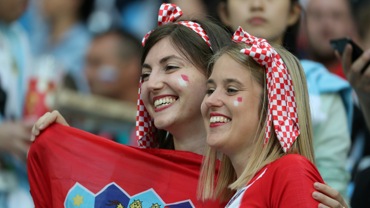 Croatian supporters pose for pictures inside the stadium during the World Cup match between Argentina and Croatia on Thursday.