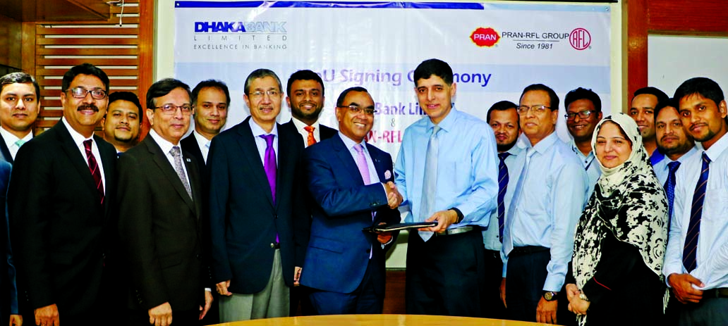 Syed Mahbubur Rahman, Managing Director of Dhaka Bank Limited and Ahsan Khan Chowdhury, Chairman of PRAN-RFL Group, exchanging a MoU signing documents of Payroll Banking and Cash Management Services at PRAN-RFL Center in the city recently. Emranul Huq, AMD, Md. Shakir Amin Chowdhury, DMD of the bank, Uzma Chowdhury, Director and Choudhury Atiur Rasul, Director (Accounts) of the group among others were also present.