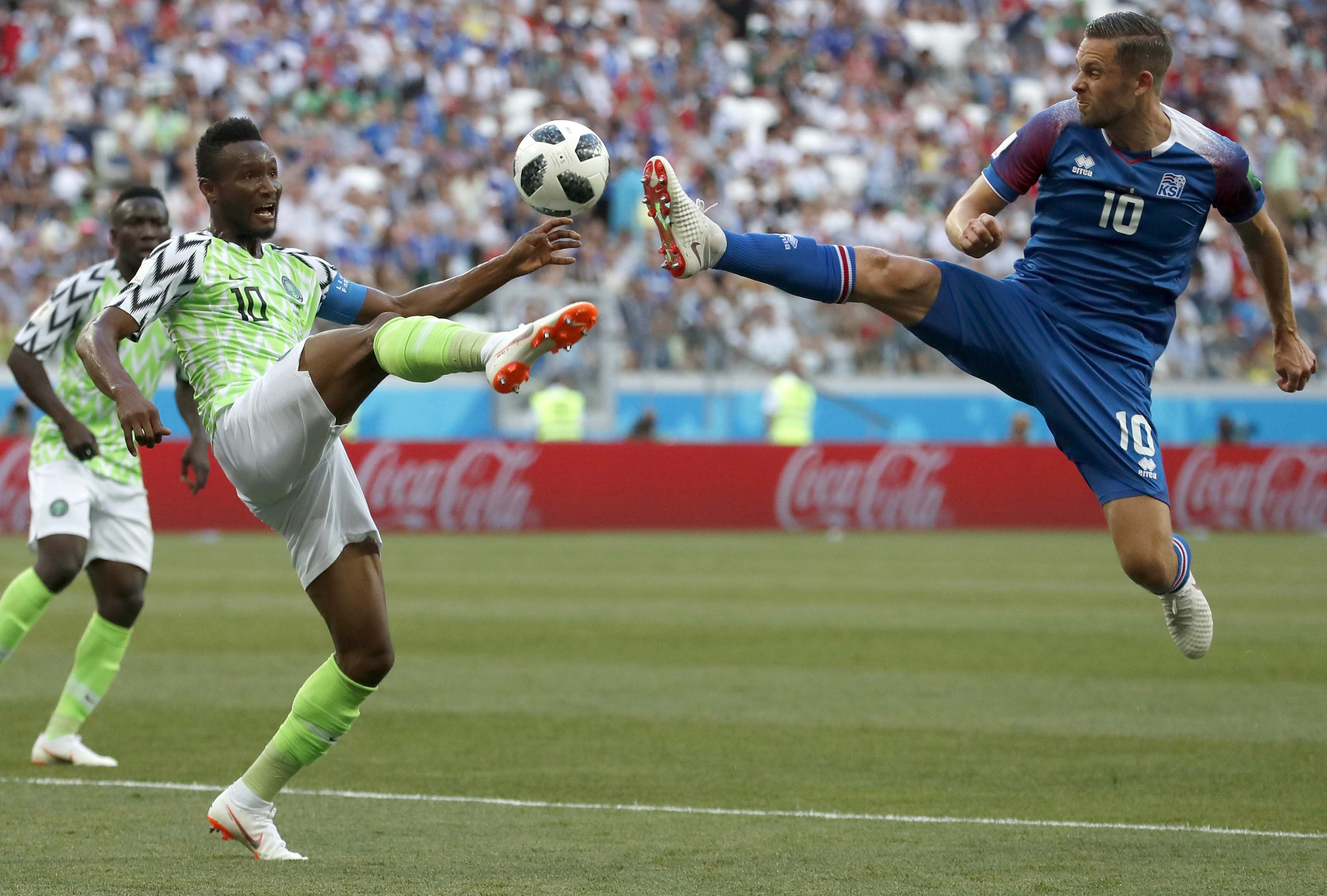 Nigeria`s John Obi Mikel (left) and Iceland`s Gylfi Sigurdsson compete for the ball during the group D match between Nigeria and Iceland at the 2018 soccer World Cup at the Volgograd Arena in Volgograd, Russia on Friday.