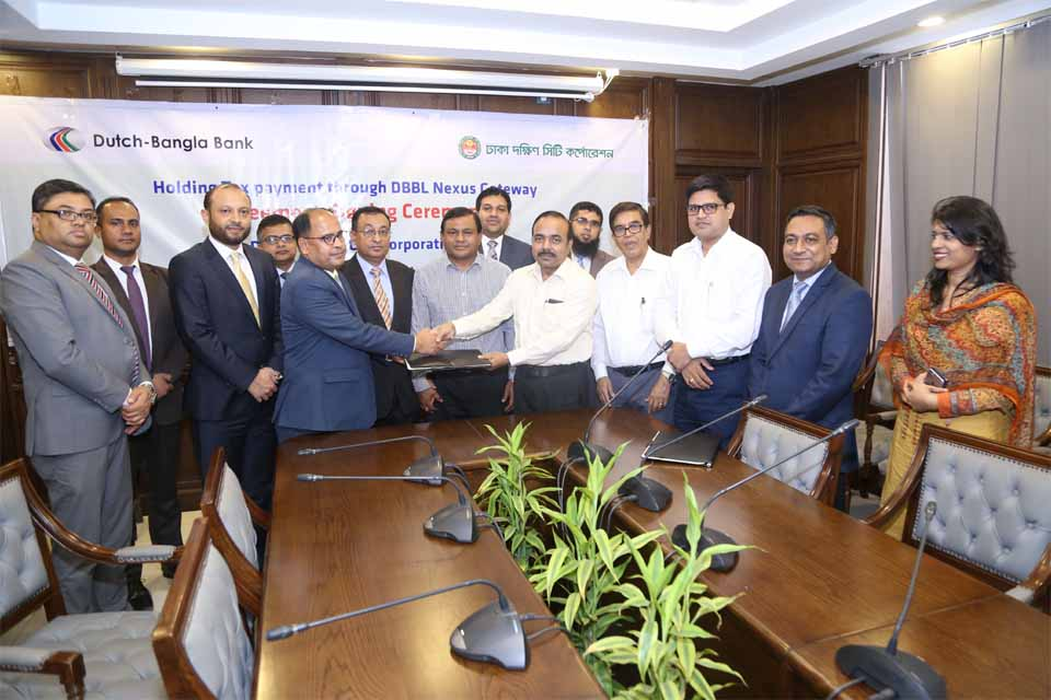 Khan Mohammad, CEO Dhaka South City Corporation (DSCC) and Md. Mosharraf Hossain, First Vice President of Dutch-Bangla Bank Limited, exchanging an agreement signing documents at DSCC office recently. Under the deal, dwellers of DSCC will be able to pay their holding tax online using their DBBL Nexus Debit Card, Rocket Account, VISA and MasterCard issued by any bank and also can pay tax at DBBL Agent Banking outlets. Md. Abdul Khaleque, Joint Secretary, Local Government Division, Md. Shahabuddin Khan, Secretary (Joint Secretary) of DSCC and Md. Abul Kashem Khan, Abedur Rahman Sikder, SEVPs of the bank were also present.