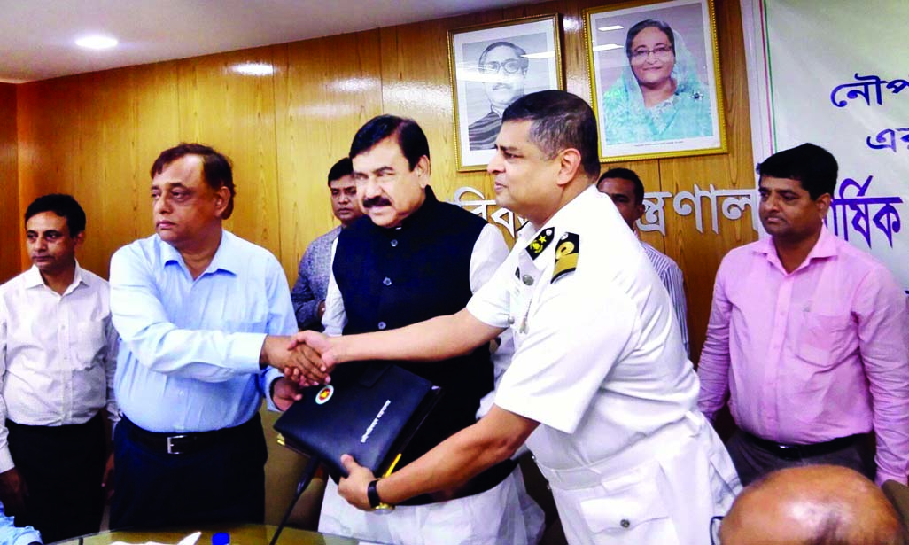 Shipping Minister Shajahan Khan handing over annual work agreement documents to the officials of different institutions of the Ministry after signing the contract at Ministry's Conference Room yesterday.