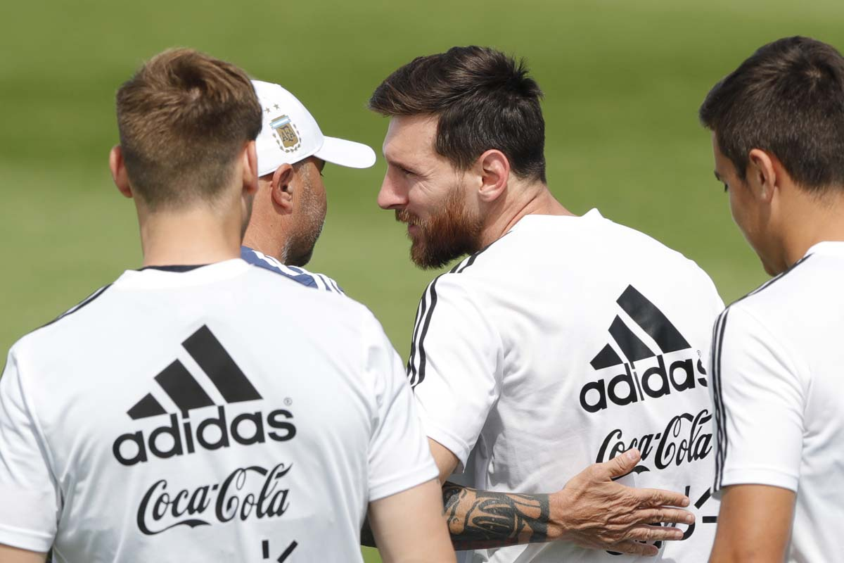 Lionel Messi is congratulated by coach Jorge Sampaoli on the day of his birthday during a training session of Argentina at the 2018 soccer World Cup in Bronnitsy, Russia on Sunday.