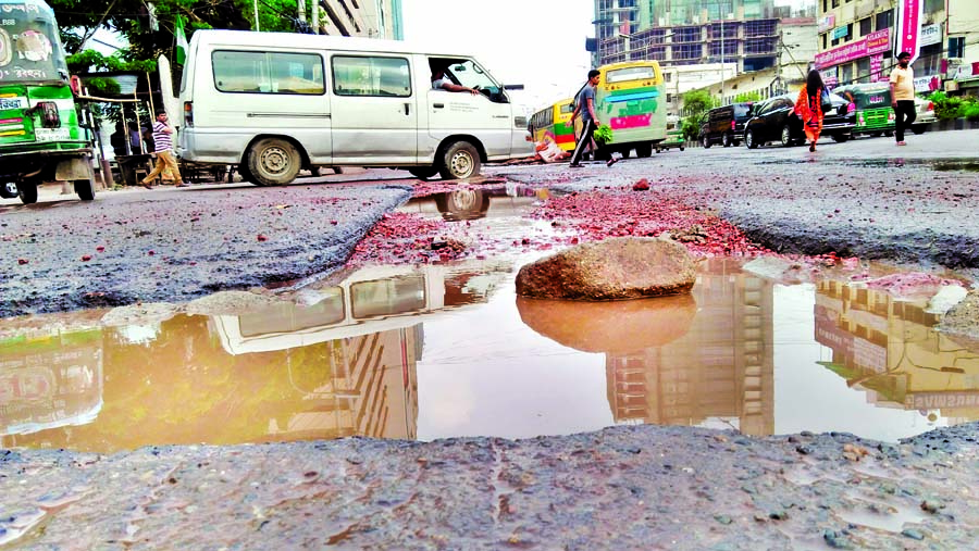 Sorry state of a busy road in city's Karwan Bazar area. This picture was snapped on Sunday.