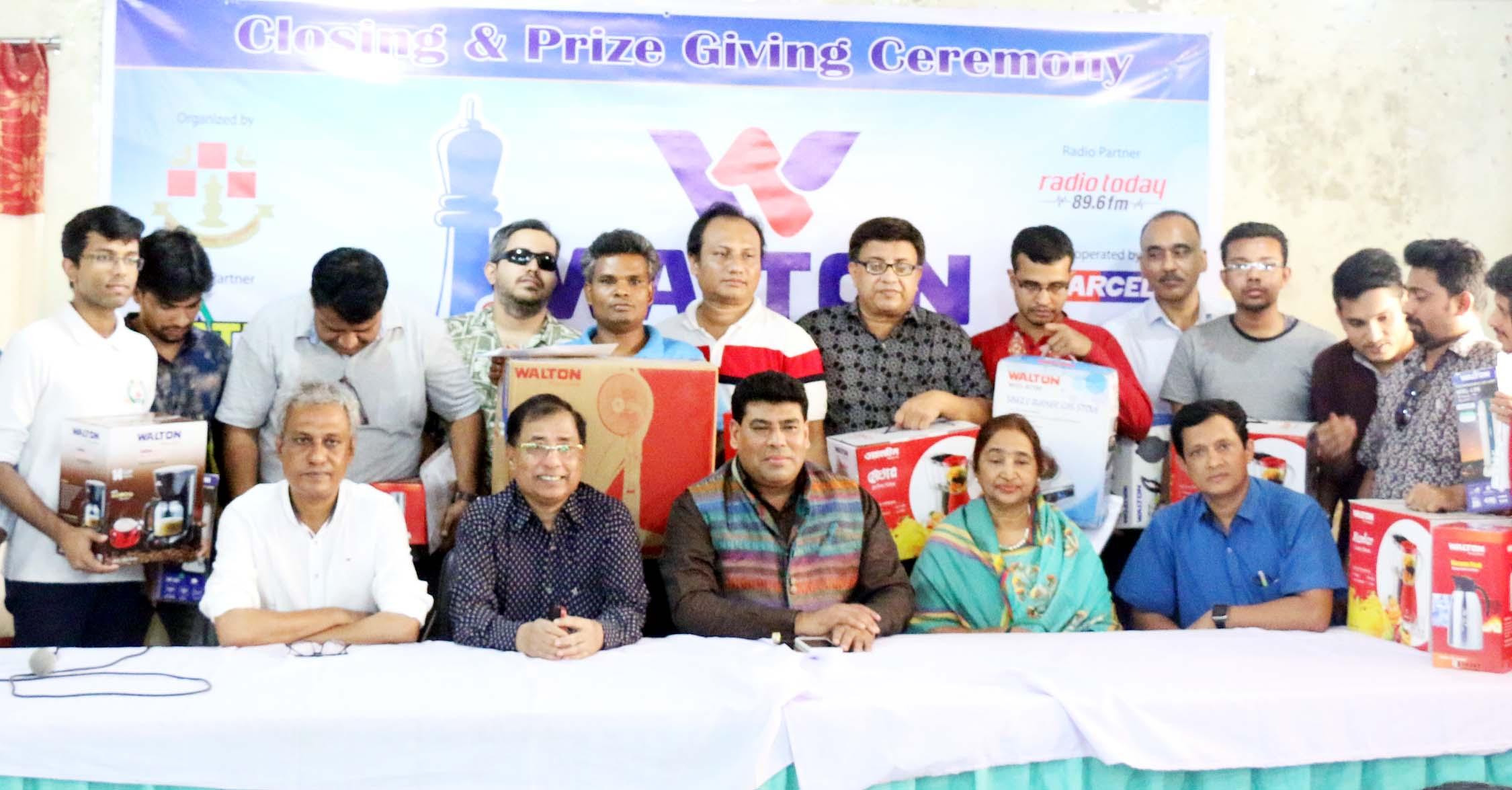 The winners of the Walton Metropolis FIDE Rating Chess Tournament with the chief guest Senior Operative Director (Head of Games & Sports) FM Iqbal Bin Anwar Dawn and the officials of Bangladesh Chess Federation pose for a photo session at Bangladesh Chess Federation hall-room on Thursday.