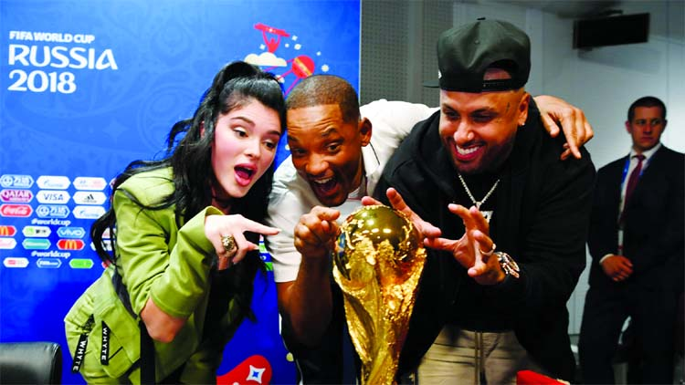 Era Istrefi, Will Smith and Nicky Jam pose with the World Cup trophy at a press conference during the 2018 FIFA World Cup at Luzhniki Stadium in Moscow, Russia on Friday.