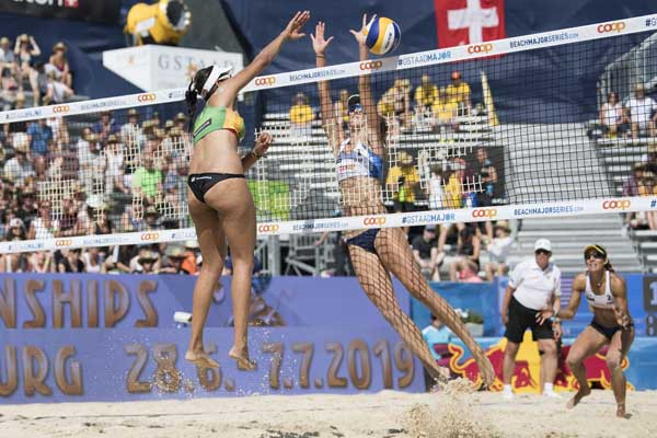 Eduarda of Brazil, left, spies past Kelley Larsen of the US during their women's quarter final game at the Beachvolley Worldtour Major Series, in Gstaad, Switzerland on Saturday.