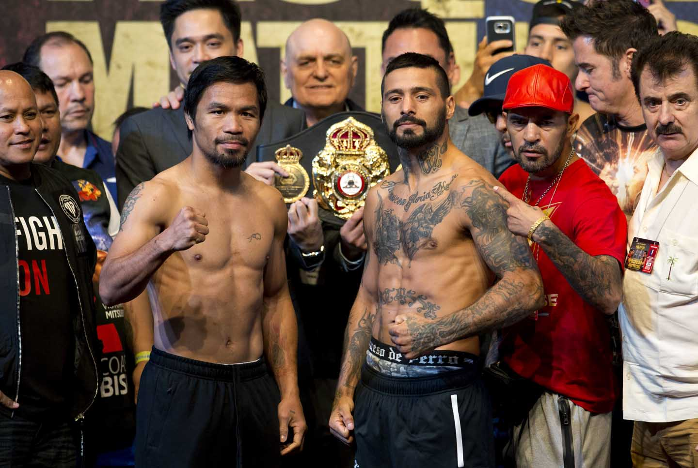 Philippine senator and boxing hero Manny Pacquiao (left) and Argentine World Boxing Association welterweight champion Lucas Matthysse pose after weigh-ins in Kuala Lumpur, Malaysia on Saturday. Matthysse and Pacquiao are scheduled to fight on July 15 for the World Boxing Association welterweight title in Malaysia.