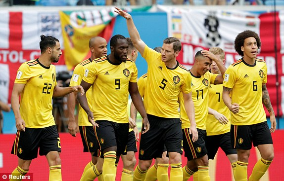 Belgium players celebrate after Thomas Meunier`s goal gave them an early lead in the third-place playoff against England.