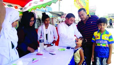TRISHAL (Mymensingh):  A B M Anisuzzaman , Mayor, Trishal Pourashava administering  Vitamin 'A' Plus on Saturday.