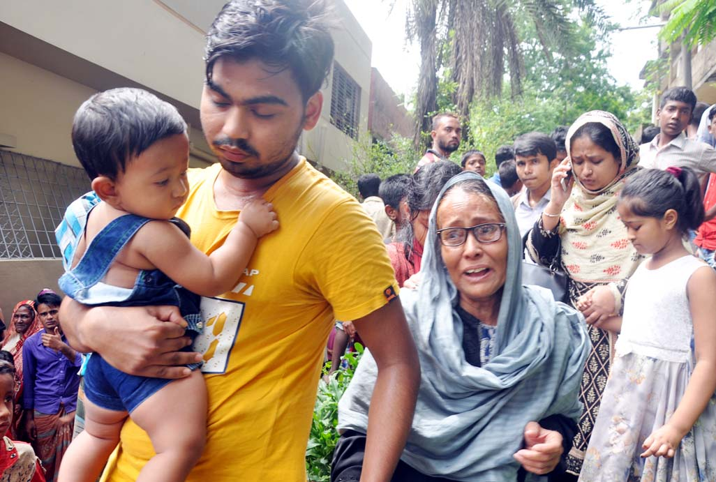 Relatives of mother and daughter murder at Khulshi area wailing after hearing the news on Sunday.