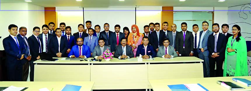 Md. Mehmood Husain, Managing Director of NRB Bank Limited poses with the participants of the 1st Foundation Training Course of the bank inaugurated at its training center on Sunday. Imran Ahmed FCA, Chief Operating Officer, Rahat Shams, Head of Retail Banking, Imteeaz Ahmed, Head of Human Resources Division and Mohammad Rafiqul Islam, CDCS, Head of Learning and Development are, among others, seen in the picture.