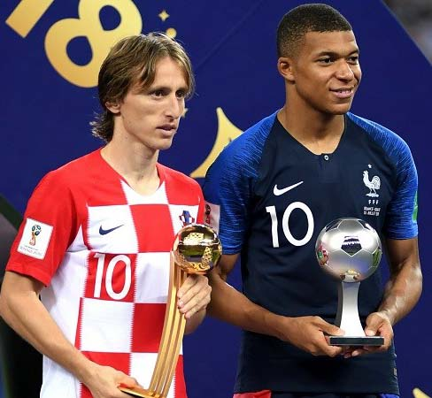 Luka Modric (left) poses with the Golden Ball with Kylian Mbappe holding his Young Player Award on Sunday.