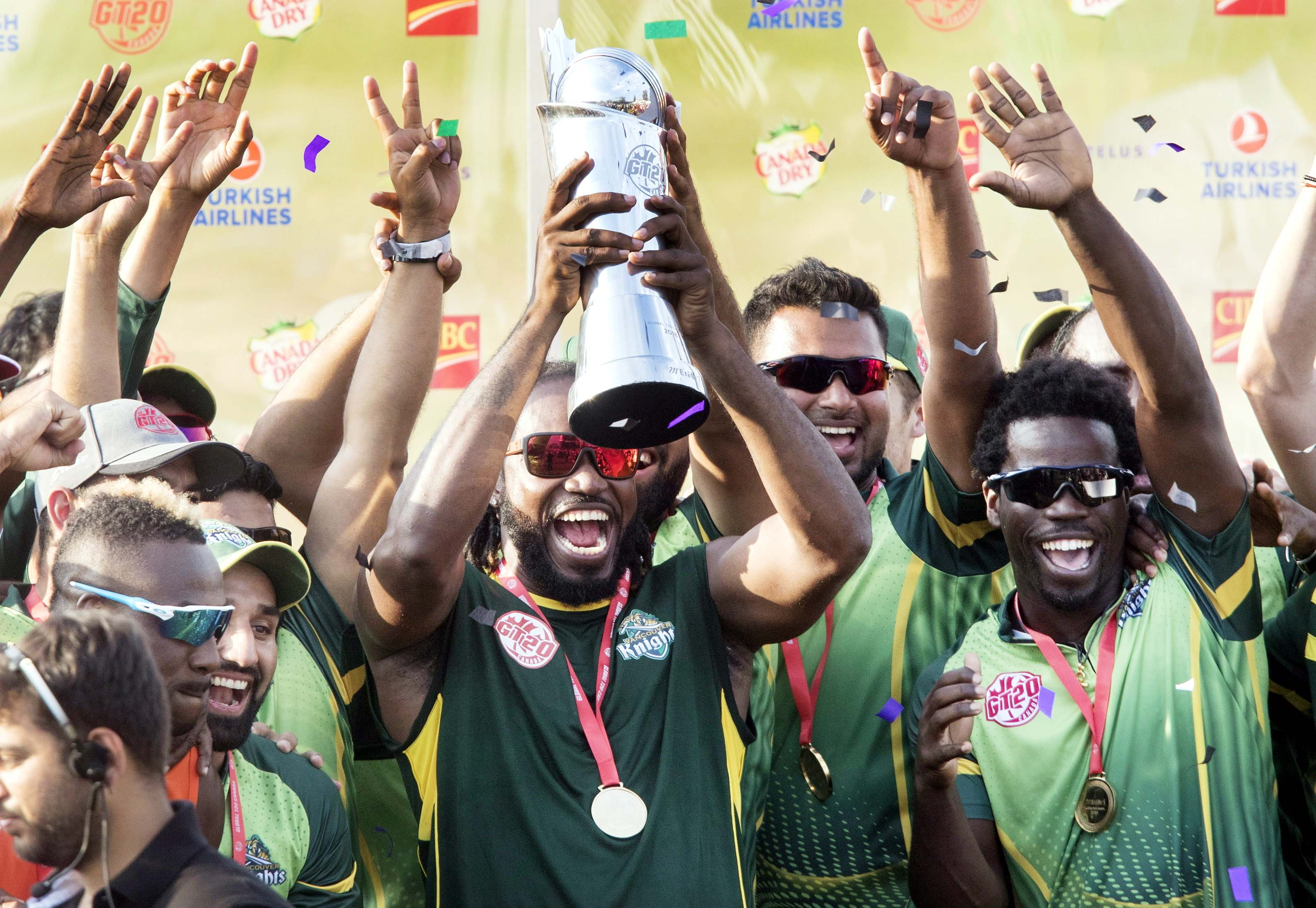 Vancouver Knights' Chris Gayle holds up the trophy after his team defeated the West Indies B Team in their final of the Global T20 Canada cricket tournament in King City, Ontario, on Sunday.
