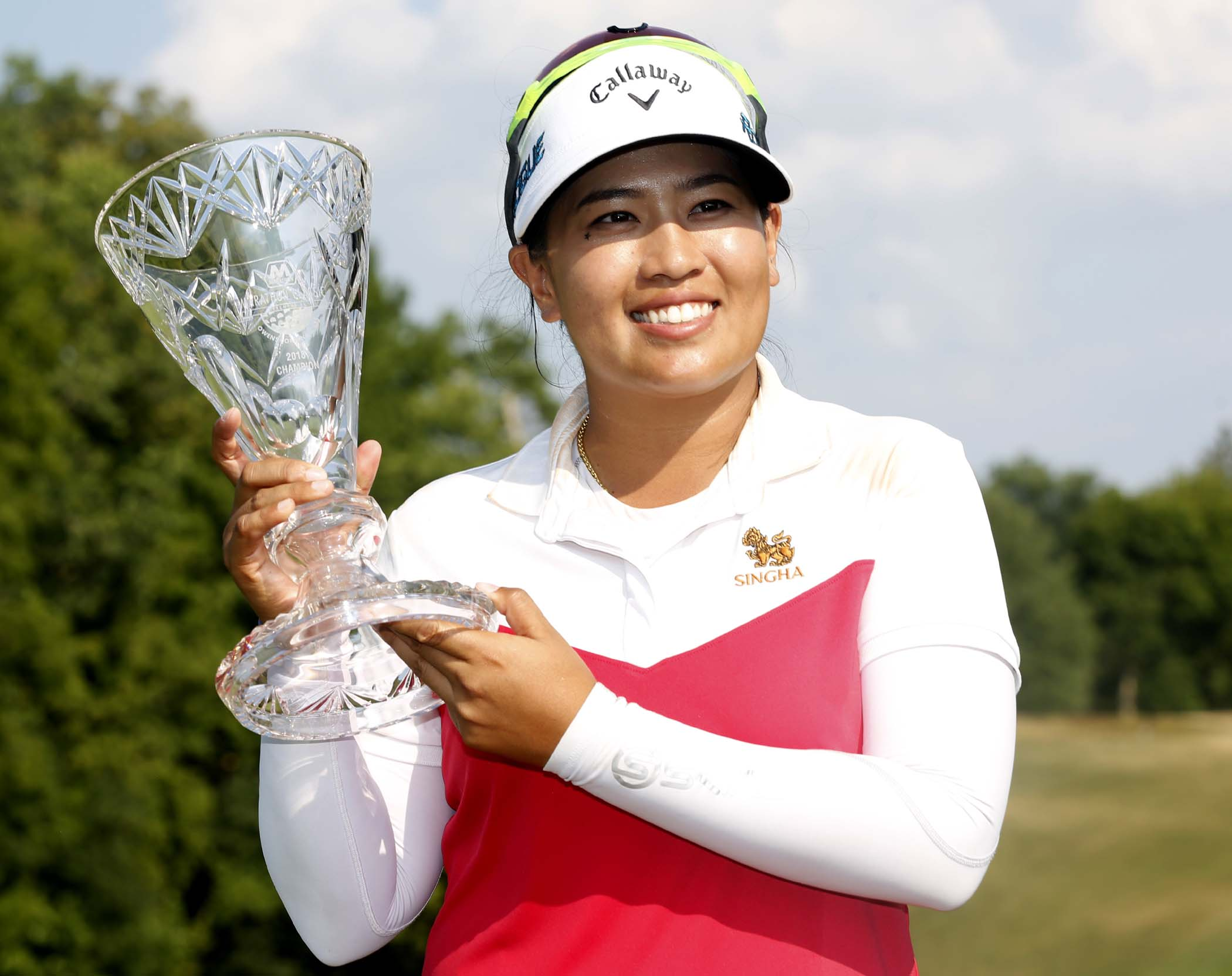 Thidapa Suwannapura poses with the trophy after winning the LPGA golf Marathon Classic on Sunday at Highland Meadows in Sylvania, Ohio.