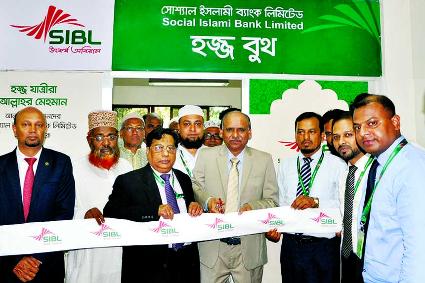 Quazi Osman Ali, Managing Director of Social Islami Bank Limited, inaugurating a Hajj Booth as the chief guest at the Hajj Camp at Ashkuna in the city on Tuesday for rendering services to the Hajj Pilgrims.  Ihsanul Aziz, Additional Managing Director, Md Mahfuzur Rahman, SAVP and other officials of the bank were also present.