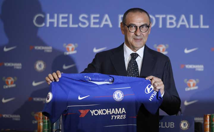 Maurizio Sarri, the new Chelsea soccer team manager, holds up a jersey during a press conference for his official presentation at Stamford Bridge stadium in London on Wednesday.