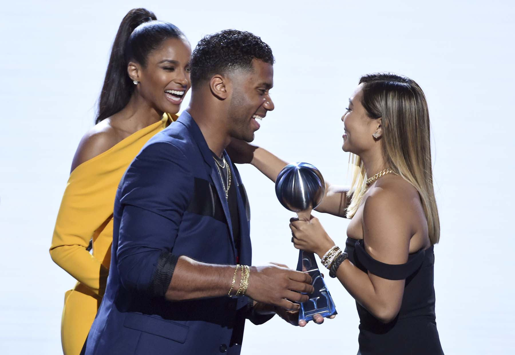 Ciara (left) and Seattle Seahawks' Russell Wilson present the award for best female athlete to snowboarder Chloe Kim at the ESPY Awards at Microsoft Theater on Wednesday in Los Angeles.