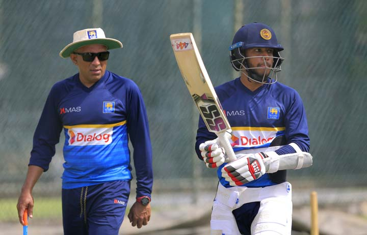 Sri Lanka's batsman Kusal Mendis (right) and coach Chandika Hathurusingha attend a training session ahead of their second Test cricket match against South Africa in Colombo, Sri Lanka on Thursday. The second Test begins today.