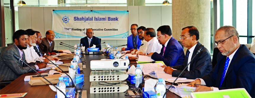Anwer Hossain Khan, Chairman of the Executive Committee (EC) of Shahjalal Islami Bank Limited, presiding over its 750th meeting of the EC held recently at the Banks's head office. Among others, the Vice-Chairman of the EC Fakir Akhtaruzzaman, the Directors and Member of EC Khandaker Shakib Ahmed, Engineer Md. Towhidur Rahman, Mohammed Younus, Md. Sanaullah Shahid,  Mohiuddin Ahmed and, the Chairman of the Board of Directors  Akkas Uddin Mollah were present as special guest. Managing Director  Farman R Chowdhury, Additional Managing Director  M. Shahidul Islam and the Deputy Managing Director  Md. Shahjahan Shiraj were also present in the meeting.
