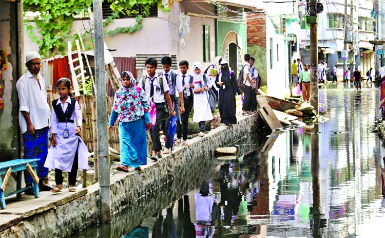 Vast areas of Matuail remain under water for several months forcing the locals to pass through the space mean for constructing foothpath.