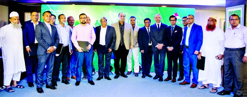 Sohail R. K. Hussain, Managing Director of City Bank and Antoine Predour, Head of Global Climate Partnership Fund, are seen posing at the event 'Green Champion Recognition Ceremony' at the Bank's Head Office recently. Rathin Kumar Paul, Deputy GM, Bangladesh Bank, Sheikh Mohammad Maroof, DMD and Head of Wholesale Banking of City Bank, Sathish Dhanapal, Energy Specialist, GCPF and other leading RMG and Textile Manufacturers were also present.