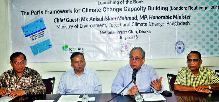 Anisul Islam Mahmud, Minister for Environment,  Forest and Climate Change speaking as Chief Guest at a launching of book titled ' The Paris framework for climate change capacity building' at  Jatiya  Press Club yesterday.