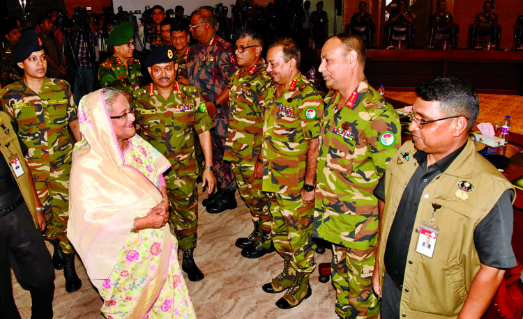 Prime Minister Sehikh Hasina exchanging greetings with  high officials  at the meeting of  Army  Headquarters Selection Board-2018 at Dhaka Cantonment yesterday.