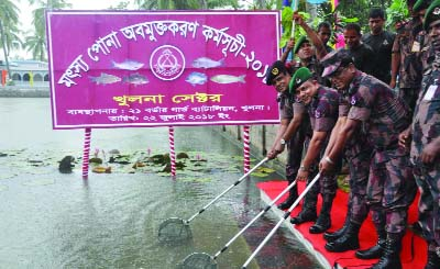 KHULNA:  Colonel  Md Towhidul Islam, Sector Commander, Khulna Border Guard releasing fish fries in water bodies   at Khulna Sector Headquarters  on the occasion of the National Fisheries Week on Sunday.