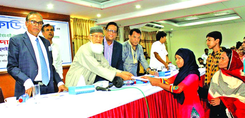 Engineer A.K.M Mosharraf Hossain, Chairman, Jamuna Bank, handing over scholarships to students at