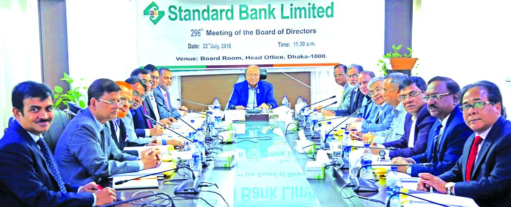Kazi Akram Uddin Ahmed, Chairman of the Board of Directors of Standard Bank Limited, presiding over its 296th meeting at its head office in the city on Sunday. Mamun-Ur-Rashid, Managing Director, Mohammed Abdul Aziz, Vice-Chairman, Kamal Mostafa Chowdhury, Ashok Kumar Saha, S A M Hossain, Mohammed Shamsul Alam, Gulzar Ahmed, Mohd. Yousuf Chowdhury, Ferdous Ali Khan, Kazi Sanaul Hoq, S S Nizamuddin Ahmed and Md. Nazmus Salehin, Directors of the Bank, among others, were present.