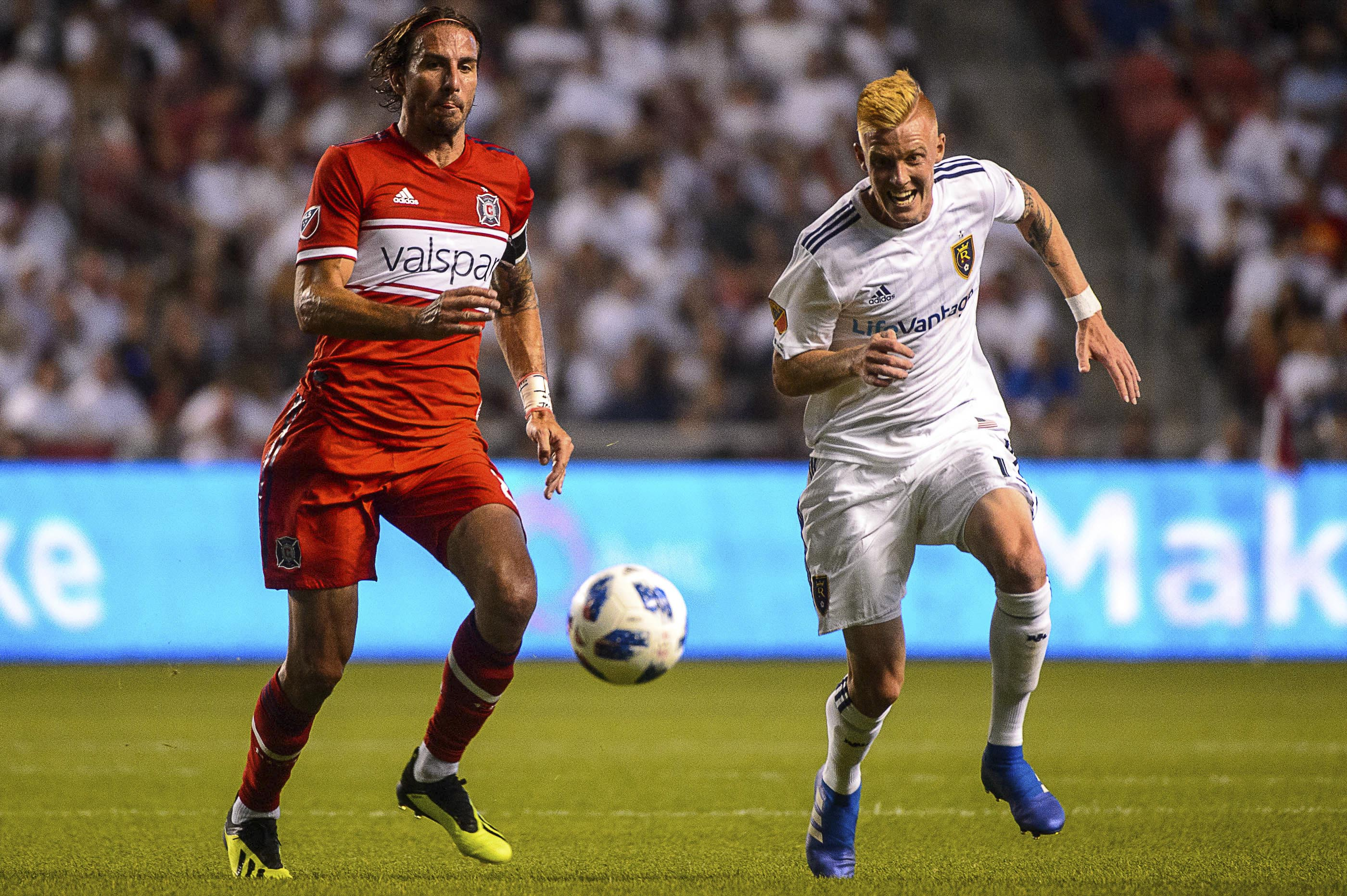 Chicago Fire forward Alan Gordon (left) and Real Salt Lake defender Justen Glad (15) vie for the ball during an MLS soccer game in Sandy, Utah on Saturday.
