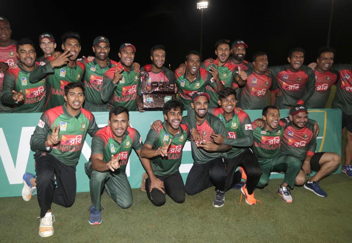 Players of the Bangladesh team pose with the trophy after Bangladesh defeated the West Indies in a Twenty20 international cricket match  in Lauderhill, Fla on Monday. Bangladesh won by 19 runs to clinch the series.