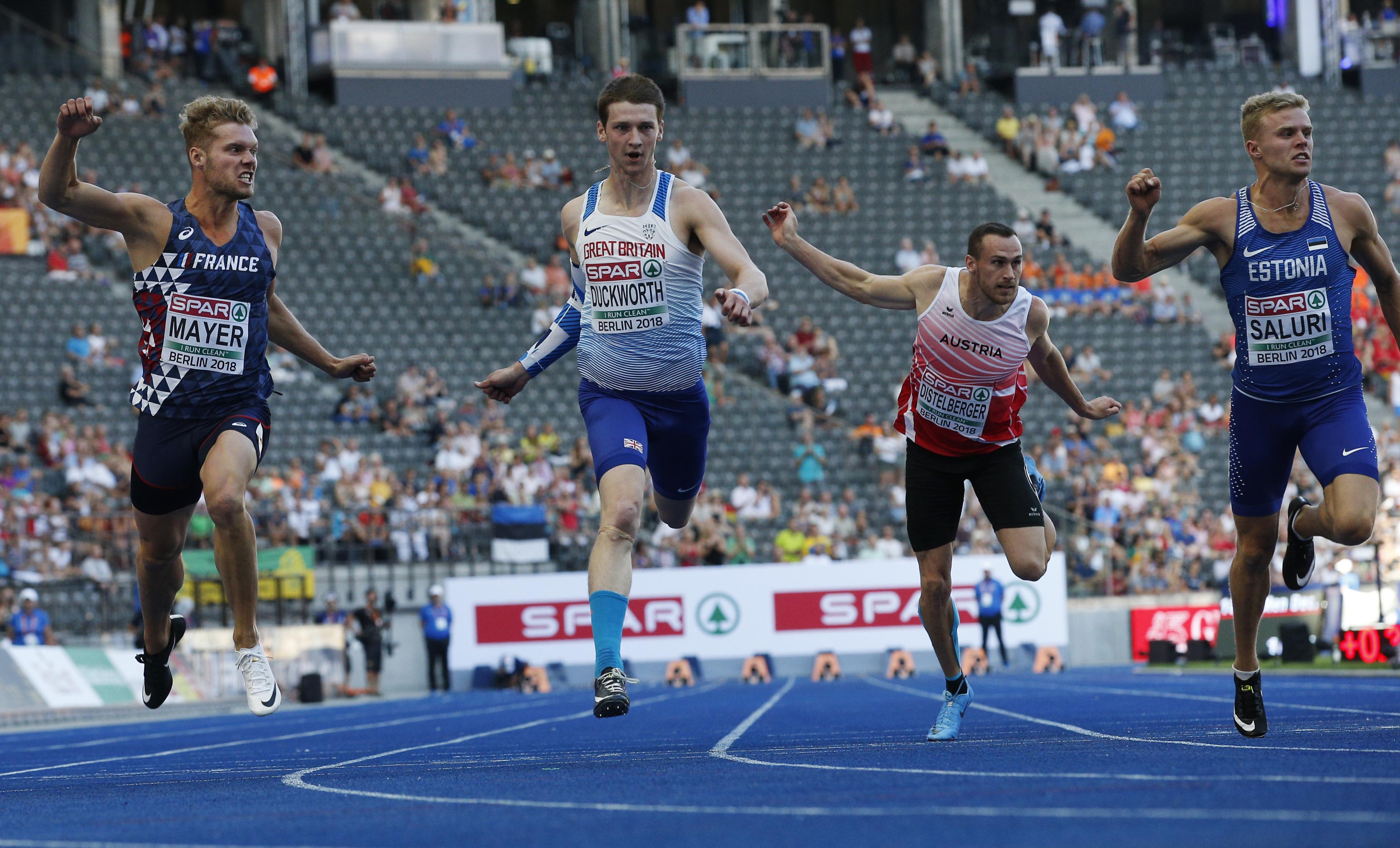 France's Kevin Mayer, Britain's Tim Duckworth, Austria's Dominik Distelberger and Estonia's Karl Robert Saluri, from left, cross the line of the 100-meter event of the decathlon at the European Athletics Championships in Berlin, Germany on Tuesday.