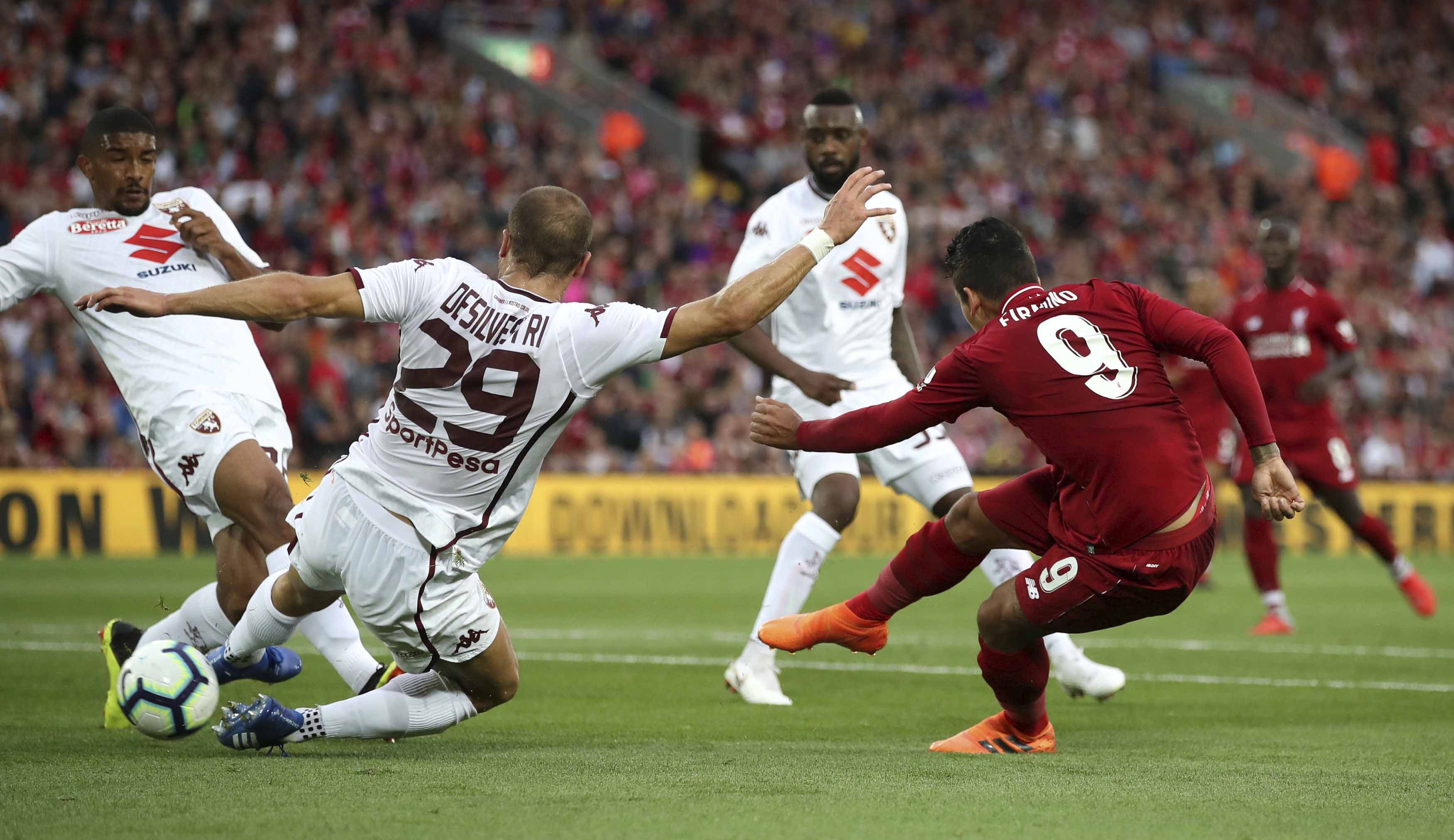 Liverpool's Roberto Firminho (right) scores his side's first goal of the game during the pre-season soccer match between Torino and Liverpool at Anfield, Liverpool, England on Tuesday.